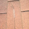 Cracked roof shingle
